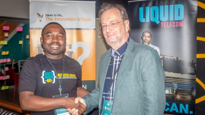 (In Pictorial from L-R): CK Japheth; CEO and Co-Founder of The Innovation Village and Hans Haerdlte; CEO Liquid Telecom Uganda shake hands in a new partnership to support Uganda based startup. This was during the press media briefing at the Innovation Village, Kampala on 30th November, 2017.
