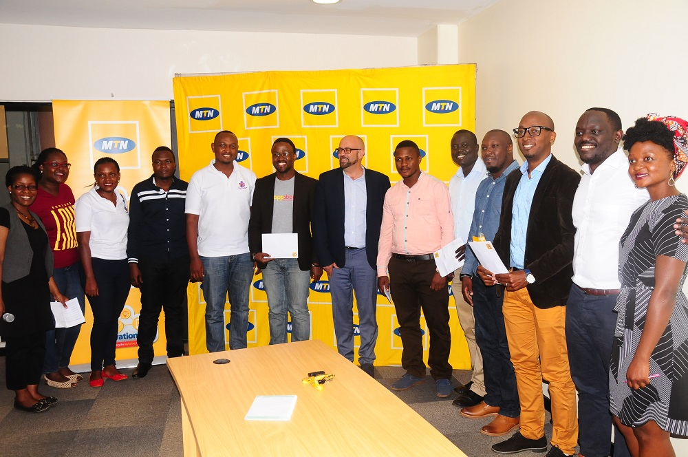 Photo of MTN Innovation Award winners receive their cash prizes, up to a total of UGX.97.2m
