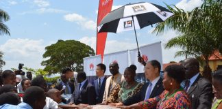 BUKEB Chairman Mr. Kiswiri Arnold (Middle) receiving the donation as Bai Chengyu from Huawei, (3rd left), Hon. Rebecca Kadaga, Speaker of Parliament (3rd Right), H.E. Zheng Zhuqiang, The Chinese Ambassador (2nd Right) with other dignitaries in Busoga.