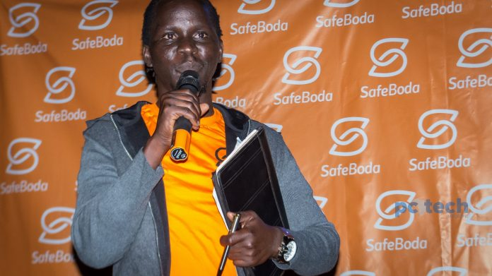 Ricky Rapa Thomson; Co-Founder of ride-hailing firm; SafeBoda, addressing the press and the guests while they were launching their campaign #YourCityRide at their new offices in Bukoto.