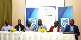 (L-R) Robert Mpunga; Head of Treasury at Bank of Africa, Faisal Bukenya; Head of Treasury at Exim Bank, Charles Katongole; Head of Markets at Standard Chartered Bank, Ronald Muyanja; Head of Trading at Citi Bank, David Wandera; Head of Markets at Barclays Bank and Hosea Akena; Head of Treasury at Eco Bank during a panel discussion at the ACI Financial Markets forum hosted by Stanbic Bank at the Sheraton Kampala Hotel.