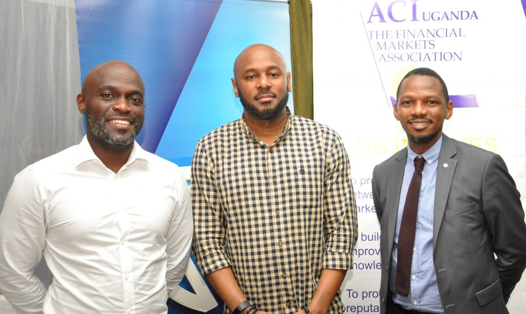 (L-R) Timothy Nkata; Head Forex Trading Bank of Uganda, Benoni Okwenje the ACI Uganda Chairman and Fixed Income Manager at Stanbic Bank, and Alan Norman Lwetabe Assistant Director Financial Markets Bank of Uganda at the ACI Financial Markets forum hosted by Stanbic Bank at the Sheraton Kampala Hotel on Friday 23rd, March 2018.