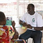 Teheca CEO and Co-Founder; Ruyongo Daniel talking to one of their clients. (Photo credit: Teheca)