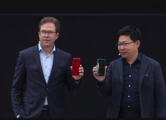 Dr. Jan Becker (L) CEO at Porsche Design and Richard Yu (R) CEO at Huawei Consumer Business Group pose with the new Huawei P20 and P20 Pro during their launch in Paris, France on Tuesday 27th March, 2018 | Photo Credit : PC Tech Magazine/Olupot Nathan Ernest.