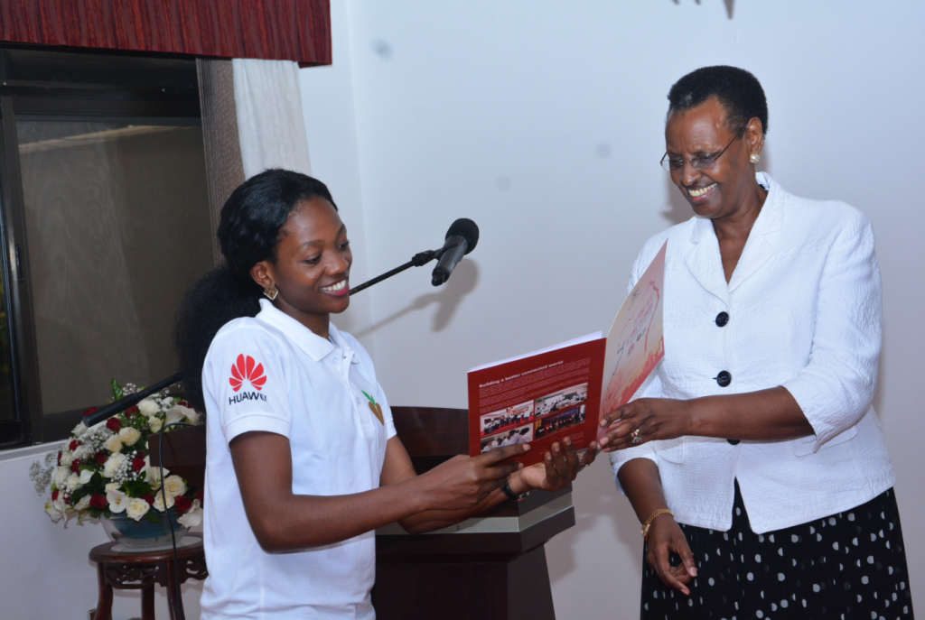 Nakate Annet Mary from Muni University pictured giving the first lady; Janet K. Museveni a copy of the seeds for future program book during the flag off ceremony at the State House on Thursday 29th March, 2018.