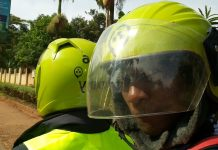 A passenger takes a photo of himself on a taxifyboda. (Photo Credit: Twitter - @rideshareuganda)