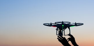 Viareggio, Italy - October 30, 2014: Drone takes off from the operator's hand with camera at sunset Quadcopter industry is told to be growing at triple digitsevery year, for a market expected to pass the 20 billion in the 2020. The dji is a chinese company leader of quadcopter industry, and the phantom is expected to be the top seller gift for christmas 2015. (Photo Credit)