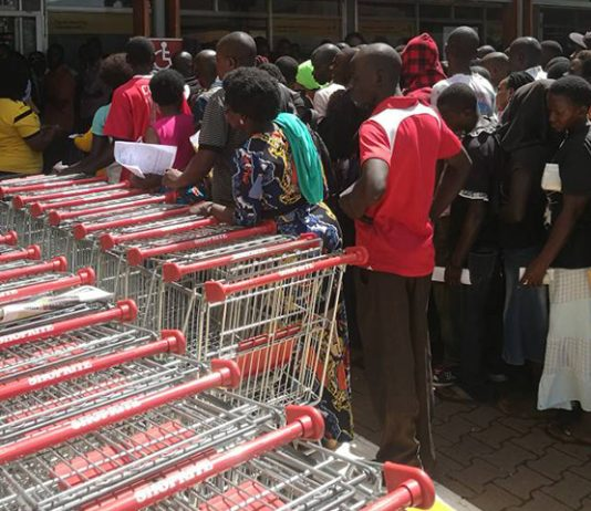 MTN customers seen lined up to re-swap/replace their simcards at the MTN service center at Shoprite-Lugogo Mall in Kampala, Uganda. (Photo Credit: Photojournalist, Pius Enywaru)