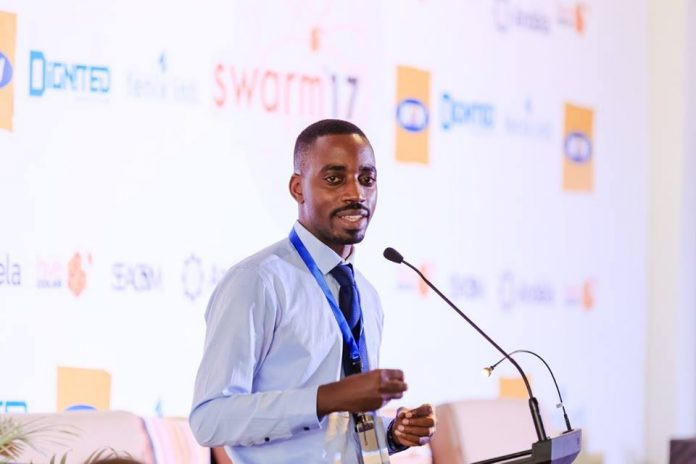 ICTAU Chairman; Albert Mucunguzi keynotes during the 2017 SWARM event organized by Hive Colab at The Square Palace in Kampala, Uganda. (Photo Courtesy: Hive Colab)