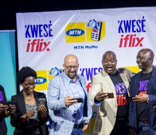 Susan Kayemba, Senior Manager Digital at MTN Uganda (Left), and MTN Uganda's Chief Marketing Officer; Olivier Prentout (2nd from Left) pose for a group photo with the Kwese Iflix team as they were trying out the Iflix app. This was at the launch of Kwese Iflix Platform in Uganda on Tuesday 12th, June 2018 at The Square Palace in Kampala, Uganda.