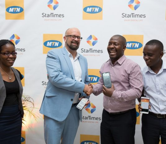 Chief Marketing Officer of MTN Uganda, Mr. Olivier Prentout shakes hands with Aldrine Nsubuga, Vice President and Brand & Marketing Director of StarTimes Uganda during the partnership announcement at the MTN Uganda HQ on Tuesday June, 26th 2018.