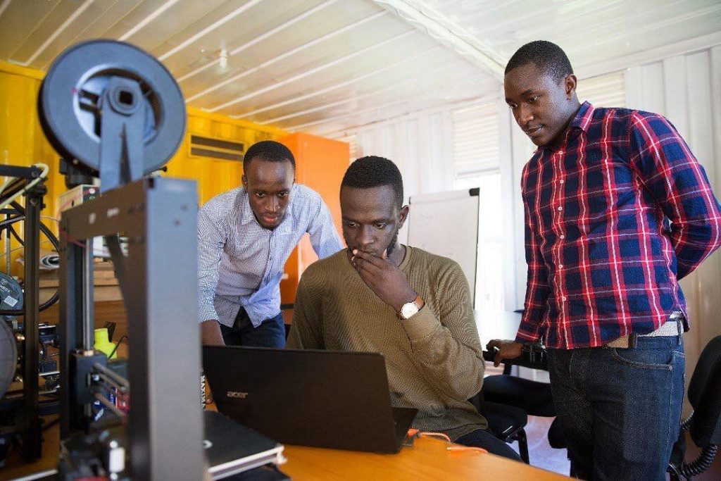 Team Matibabu of Uganda, (R to L); Shafik Sekitto, Brian Gitta, and Atwine Morris pictured working on their solutions Matibabu.