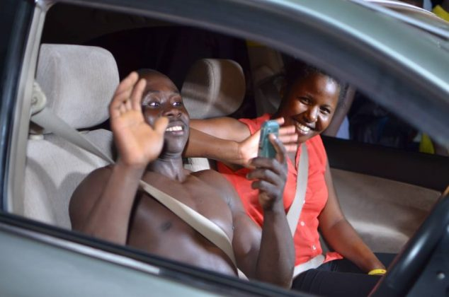 The 4th car winner, Byamukama Justus from Kiwenda, on Gayaza - Zirobwe Road jubilated and removed his shirt after he was handed over the car.