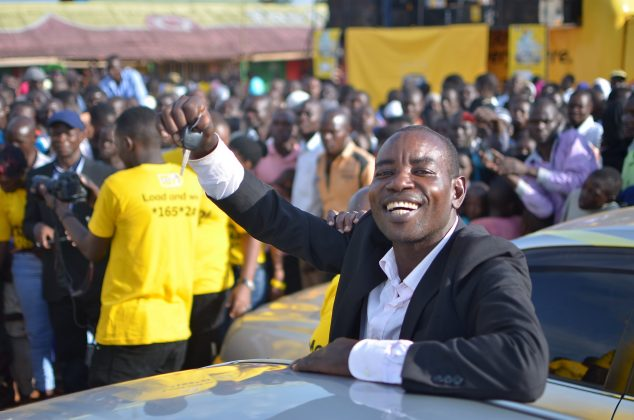 Tom Ojangole, a mason from Gogonyo in Pallisa District displays his car keys. He is the 5th MTN MoMo NYABO Car winner.