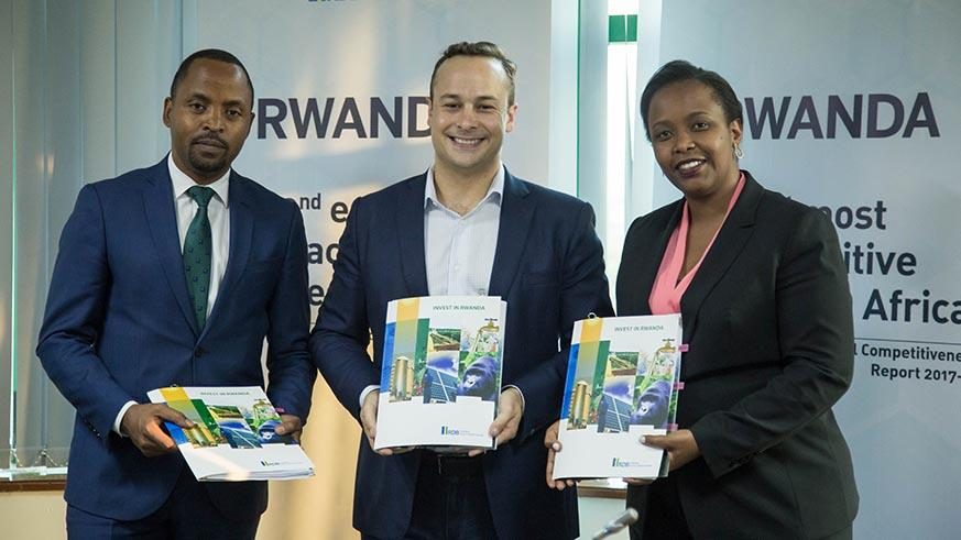 (From L - R) Minister for ITC Jean de Dieu Rurangirwa, Andela CEO Jeremy Johnson and RDB chief executive Clare Akamanzi pose for a photo after the MoU signing ceremony. (Photo Courtesy: Nadege Imbabazi @ The New Times of Rwanda).