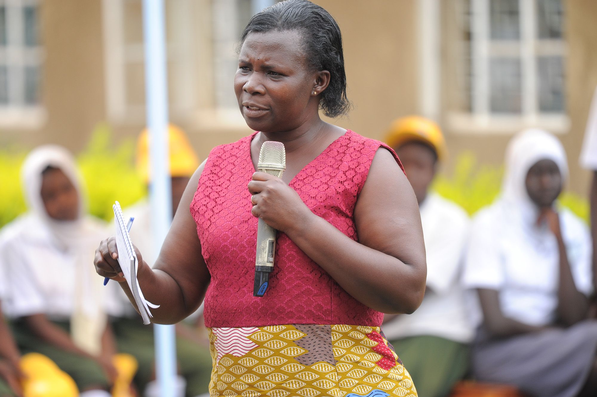 Arua District Health Commission's Medicines and Supplies Inventory Manager, Dr. Margaret Bayoru addresses the Oriajin Community at the handover of the hospital equipment.