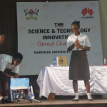 College Girls operating a Robot in the Science Technology and Innovation Challenge, an initiative of Ilabs Makerere University that Huawei has sponsored in a drive to promote innovation.
