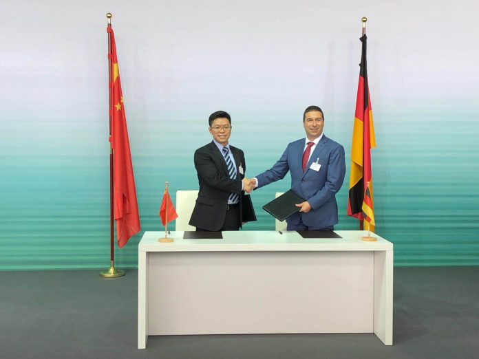 Chinese Premier; Li Keqiang and German Chancellor; Angela Merkel shake hands after signing the Memorandum of Understanding (MoU) for the development of intelligent connected vehicles.