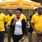 MTN Uganda's Senior Manager Corporate Affairs, Ms. Justina Ntabgoba addressing the Oriajin community, flanked by MTN Foundation staff during the handover of hosiptal equipments to Oriajin Hospital in Arua on Sunday 29th, July 2018.