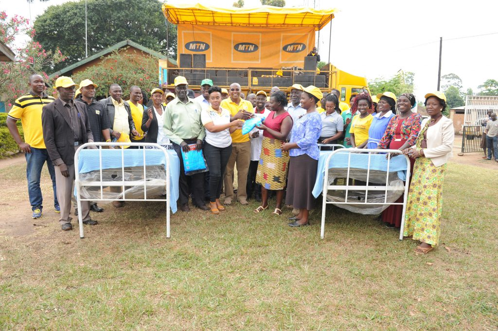 Oriajin Hospital officials receive hospital equipment from MTN Foundation. Senior Manager for Corporate Affairs, Justina Ntabgoba officially handed over the items.