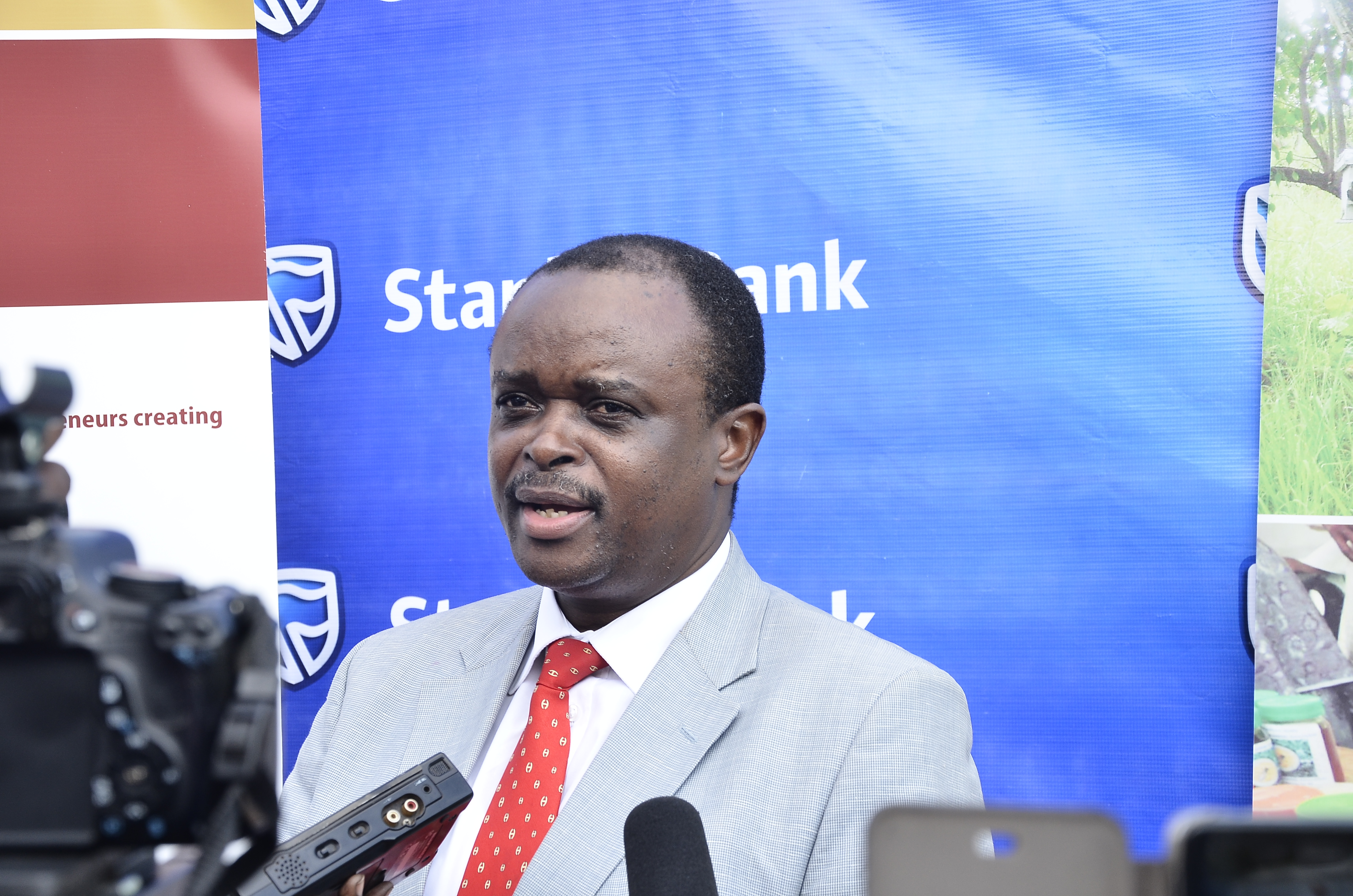Stanbic Bank Head of Agriculture Lending Richard Wangwe addresses the media after the launch of the partnership with CURAD.