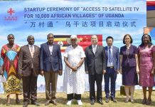 First Lady & Minister of Education and Sports; Hon. Janet Museveni (in a hat), Minister of ICT and National Guidance; Hon. Frank Tumwebaze (3rd from left), and the Chinese ambassador to Uganda; Zheng Zhuqiang (4th from right), pose for a group photo with other members of the Satellite TV Project during the launch in Wakiso on Friday 20th July, 2018. (Photo Courtesy: GCIC Uganda)