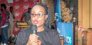 Sonia Karamagi Kassaga; Stanbic Uganda's Senior Marketing Manager, addressing the press during their partnership launch at Pizza Hut restaurant on Kisementi Avenue in Kampala, Uganda on Friday 29th, June 2018