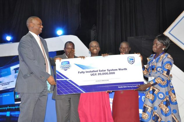 Stanbic Bank Uganda CEO; Patrick Mweheire hands over a Fully installed solar system worth UGX20,000,000 to Muni Girls as the over all winners of the 2018 Stanbic National Schools Championship.
