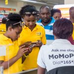 Some of the customers paying for their products using MTN MomoPay at the Ntinda Shopping Centre in Ntinda after the re-launch of the service on Thursday 16th, August 2018.