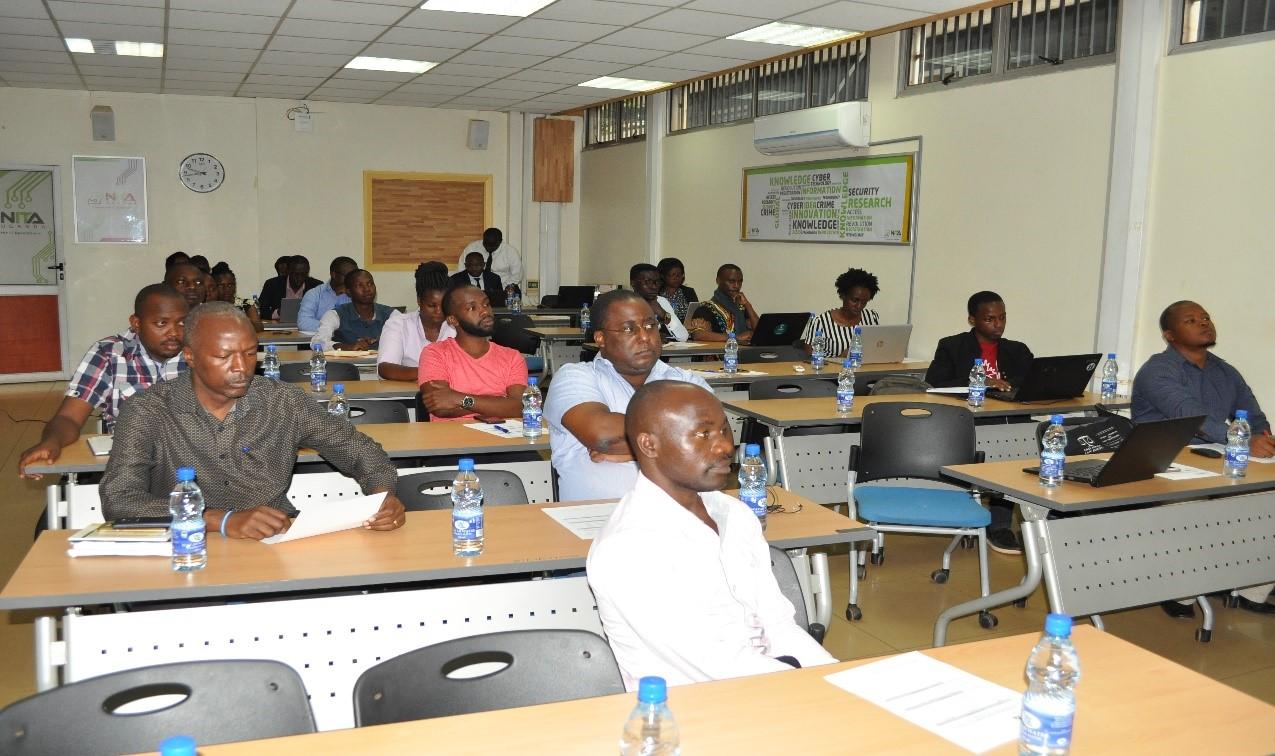 Arnold Mangeni Director Information Security at NITA-U addressing participants.