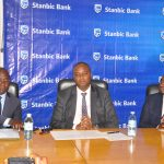 (L-R) Buganda Land Board Managing Director Kyewalabye Male, Stanbic Bank CEO Patrick Mweheire and Stanbic Bank Head of Home Loans Jackson Emanzi address the media during the launch of Kyapa Loans.