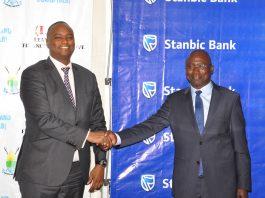 : Buganda Land Board Managing Director Kyewalabye Male and Stanbic Bank CEO Patrick Mweheire shake hands after the launch of Kyapa Loans partnership.