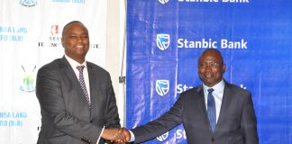 : Buganda Land Board Managing Director Kyewalabye Male and Stanbic Bank CEO Patrick Mweheire shake hands after the launch of Kyapa Loans partnership.