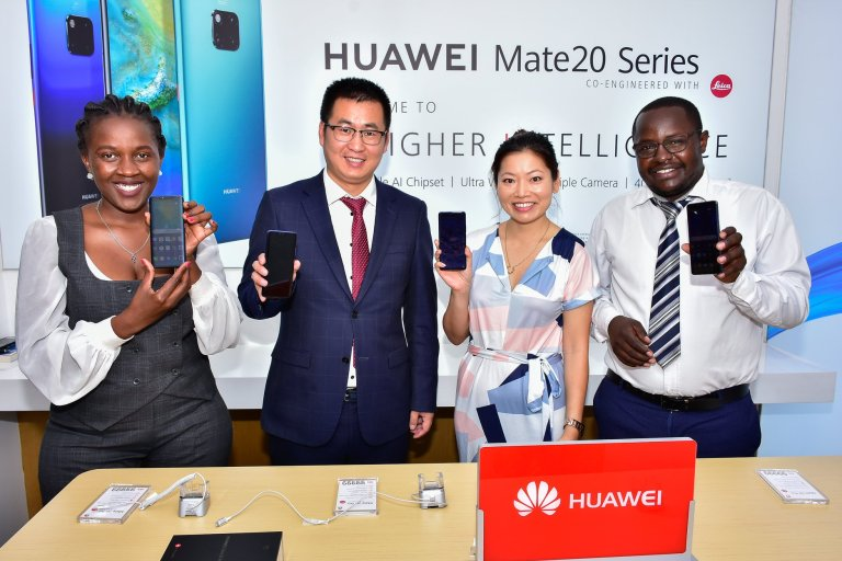 In Pictorial (L-R): Huawei's Head of Marketing Communication, Nakhulo Khaimia, Steven Li, Huawei's Head of Eastern Africa Mobile, Susan Wong Editor,Capital Lifestyle and Derrick Alenga, Training Manager pose for a group photo at the launch of Huawei Mate 20 and Huawei Mate 20 Pro in Kenya on Tuesday January, 22nd 2019. (Photo Courtesy: Tech Moran)