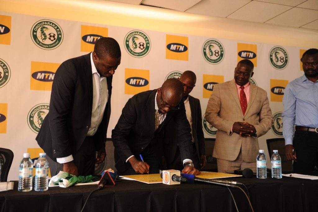 Martin Sebuliba, MTN Uganda Senior Manager Brand and Communications signs the cheque to symbolize the sponsorship. This was during a press brief held at the MTN Uganda offices in Nyonyi Gardens in Kampala on Thursday 31st, January 2019.