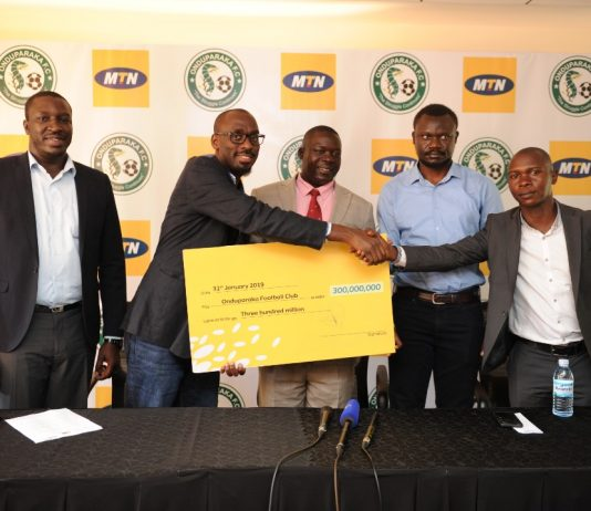 Pius Bamwange (R) the Onduparaka CEO alongside club chairman Benjamin Nyakuni and Hon Bernard Atiku the club patron receive a cheque from Martin Sebuliba (L) MTN Uganda's Senior Manager Brand and Communications during a press brief held at the MTN Uganda offices in Nyonyi Gardens in Kampala on Thursday 31st, January 2019.