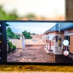 Pictured using the Tecno Camon 11 Pro to take a photo using its dual rear camera.