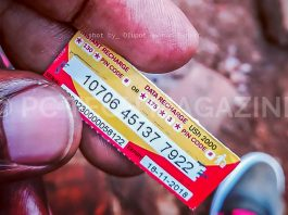 A customer seen holding a scratch/airtime card of UGX2,000 from Airtel Uganda. The scratch/airtime cards are to be terminated for customers to resort to using electronic payments to purchase their cards. (PC TECH MAGAZINE/Olupot Nathan Ernest)