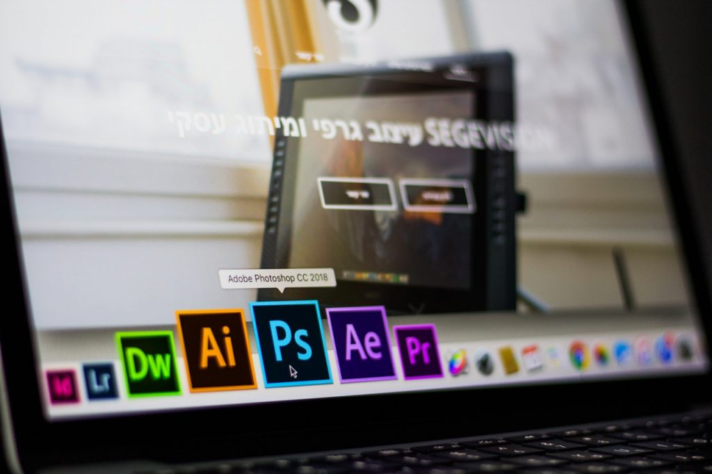 A laptop pictured showing an Adobe suit collection Photoshop, Lightroom, Premiere Pro, Dreamweaver, Affect Effects, Illustrator, and InDesign | Photo by Matan Segev from Pexels