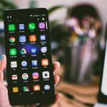 A person pictured display various types of apps on their Android smartphone | Photo by Lisa Fotios from Pexels.