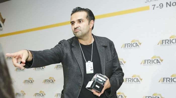 Ashish Thakkar CEO Mara Corporation showing the Maraphone prototypes during a closing plenary session at the Africa Investment Forum in Johannesburg, South Africa last year | Photo Courtesy: AfDB/File Photo.