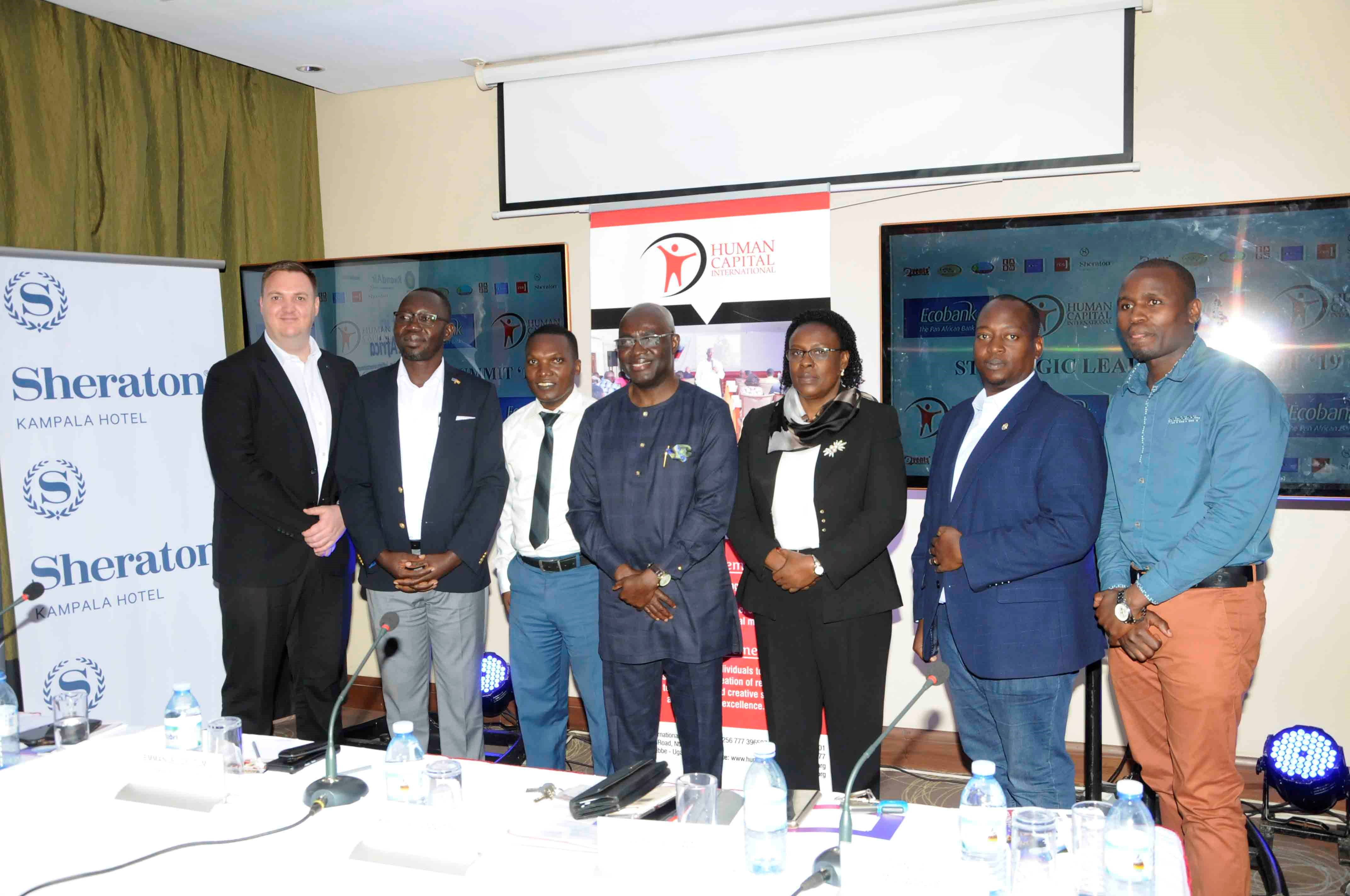 Emmanuel Dei- Tumi ; Chief Executive Office Human Capital International (4th from left) standing with sponsors of the 1st Strategic Leadership Summit set to happen on 20th of February at the Kampala Serena Hotel.