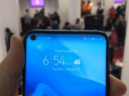 Pictured a person holding a Huawei Honor View 20 during its launch, features a hole-punched display | Photo Courtesy: TechCrunch