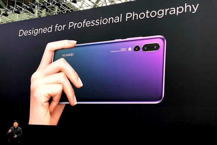 Huawei CEO for Consumer Business Group, Richard Yu (bottom left) unveils the P20 and P20 Pro in Paris on March 27, 2018 | Photo Courtesy : File Photo