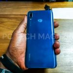 A person pictured holding the Huawei Y9 (2019) smartphone in a sapphire blue color option. (Photo - PC TECH MAGAZINE/Olupot Nathan Ernest)