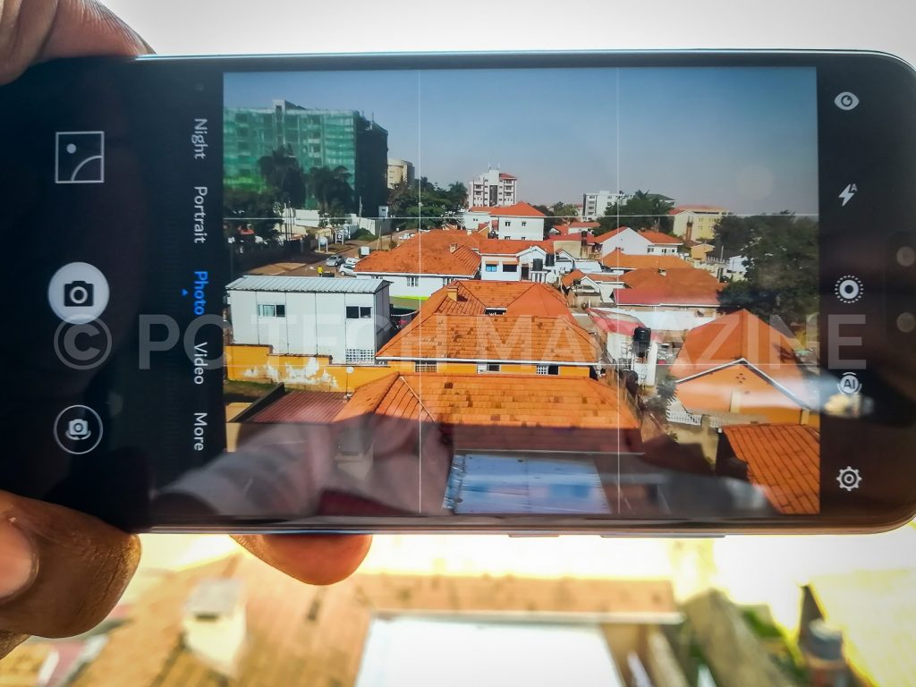 A Person pictured taking a photo using the rear camera of the Huawei Y9 (2019) smartphone. (Photo - PC TECH MAGAZINE/Olupot Nathan Ernest)