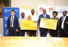 MTN Marathon partners pose for a group photo after briefing the media at a press conference held at Stanbic Uganda HQ at Crested Towers in Kampala on Thursday 14th, February 2018.