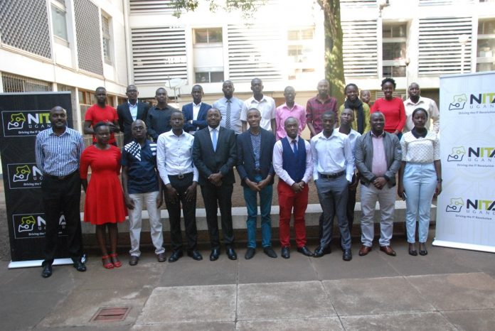Journalists from Print, Radio, Television and Online media houses pose for a group photo with the NITA-U team at the Information Access Center in Kampala on Tuesday 26th, February 2018 during their training program on Cyber security.