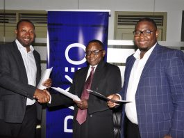 (Left –Right) Raxio's General Manager James Byaruhanga, Paul Nalikka; Director at Hamilton Telecom, flanked by Ahura Vianne Allan the CFO exchange agreements at Raxio's Rwenzori Towers, offices in Nakasero, Kampala.