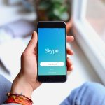 A person pictured opening the skype application on their iPhone smartphone | Courtesy Photo/File Photo